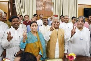 RJD leaders Rabri Devi (C) and other candidates flash victory signs after filing their nomination papers for Bihar legislative council elections, in Patna.