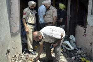 Police and forensic experts inspecting the spot, where the explosion took place, killing Vikram Singh, in Patiala on Sunday.