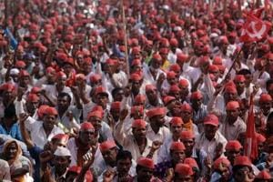 Farmers shout slogans during a rally at the end of their six-day-long march on foot, in Mumbai, on March 12.