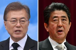 South Korean President Moon Jae-in (left) will travel to Tokyo next week for a three-way summit with Japanese Prime Minister Shinzo Abe (right) and China