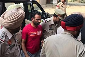 Dalit leader Harbhajan Suman being taken by police to a local court in Phagwara on Monday.
