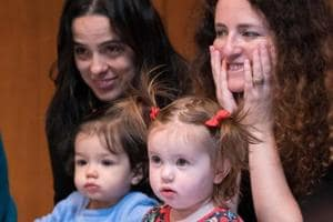 Mothers and children listen during the presentation of BambinO at the Metropolitan Opera House in New York.