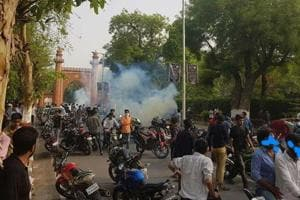Police disperse students of the Aligarh Muslim University after protests broke out over a portrait of Pakistan founder Mohammad Ali Jinnah, in Aligarh on Wednesday.