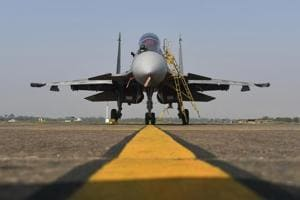 An Indian Air Force (IAF) Sukhoi fighter jet, developed by Sukhoi Aviation Holding Co., sits on the tarmac at the Kalaikunda Air Force Station, West Bengal, India.