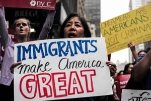 (FILES) This file photo taken on October 5, 2017 shows protesters during a demonstration against US President Donald Trump during a rally in support of the Deferred Action for Childhood Arrivals (DACA), also known as Dream Act, near the Trump Tower in New York.