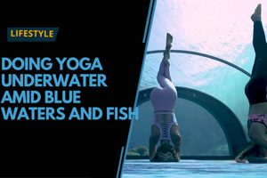 Doing yoga underwater amid blue waters and fish