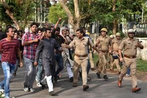 Police tries control the situation after a clash between two groups at Aligarh Muslim University on Wednesday.