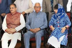 Jammu and Kashmir Governor NN Vohra with chief minister Mehbooba Mufti and deputy chief minister Kavinder Gupta at the swearing-in ceremony after the cabinet reshuffle, Jammu, May 30