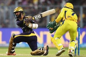 Kolkata Knight Riders (KKR) captain Dinesh Karthik (L) sweeps one to the boundary as Chennai Super Kings (CSK) skipper MS Dhoni looks on during the 2018 Indian Premier League (IPL 2018) match at Eden Gardens in Kolkata on Thursday.