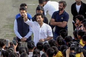 Sachin Tendulkar interacts with  young cricketers at the HPCA Stadium in Dharamsala on Thursday.