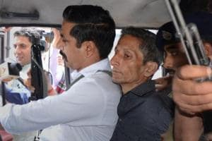 Police produce Vijay Singh, who allegedly shot dead assistant town and country planning officer Shail Bala during an anti-demolition drive on May 1, in a court in Kasauli on May 4.