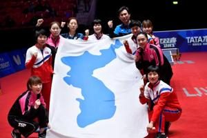Members of the unified Korea team  after the game. They lost to Japan in the World Team Table Tennis Championships semi-finals at the Halmstad Arena on Friday.