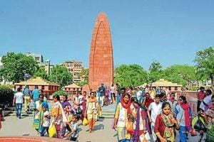 Visitors walk at the Jallianwala Bagh Memorial in Amritsar.