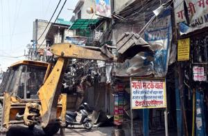 Authorities carry out demolition of illegal structures at Sadar Bazar in New Delhi on Friday.