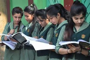 Students before appearing in the CBSE  Class 12 re-examination outside an examination centre in Moradabad.