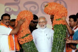 Prime Minister Narendra Modi being garlanded during a public rally ahead of the Karnataka assembly election in Tumakuru on Saturday.