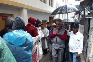 Former Uttarakhand chief minister Harish Rawat interacts with pilgrims on way to Kedarnath on Sunday.