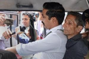 Police produce Vijay Singh, who allegedly shot dead Assistant Town and Country Planning officer Shail Bala Sharma during an anti-demolition drive on May 1, in a court in Kasauli.