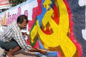 A CPI (M) worker paints a wall for the polls. The ruling CPI(M) has put up its Alappuzha district secretary Saji Cherian against BJP's former state president, PS Sreedharan Pillai and Congress veteran SD Vijayakumar.
