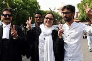 Kathua victim's lawyer Deepika Singh Rajawat flashes the victory sign outside the Supreme Court in New Delhi on Monday.