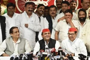 Samajwadi Party president Akhilesh Yadav and other senior leaders address a press conference after the by-election results, at the party headquarters in Lucknow on Wednesday.