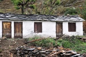 Locked doors of a house in Garhwal region. The report also warns that migration into urban areas is causing additional stress on the already over stressed towns and cities.