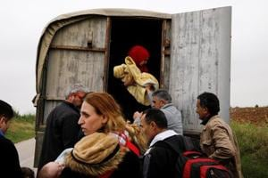 Photos: Sea route blocked, refugees turn to old smugglers' trail into Greece