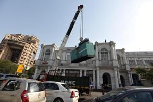 NDMC officials remove unauthorised heavy generators during an anti-encroachment drive, at N- Block in Connaught Place, New Delhi.