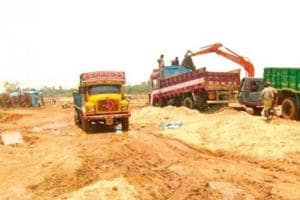 The constable's wife alleged that some officials in the police department had worked in connivance with the sand mafia.