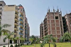 Not safe: Occupants of Royal Mansion apartments at Peer Muchalla have complained to Punjab Lokpal, alleging that the builders constructed additional floors without permission.