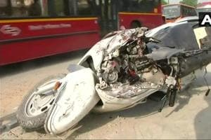 The mangled remains of the scooter that was crushed by a bus killing the rider.