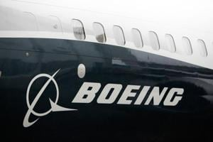(FILES) In this file photo taken on March 7, 2017 shows the Boeing logo on the Boeing 737 MAX 9 airplane at the Boeing factory in Renton, Washington.
