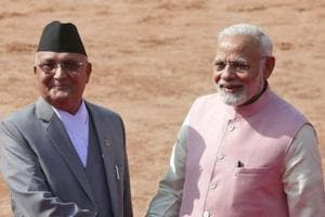 Prime Minister Narendra Modi with Nepalese Prime Minister KP Oli as the latter arrives for a ceremonial reception in New Delhi on April 7, 2018.