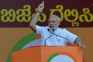 Prime Minister Narendra Modi gestures to supporters during an election rally in Bangalore, May 3