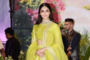 Each of Alia Bhatt's outfits is different than the one that came before. The actor wearing a neon green Sabyasachi lehenga at actor Sonam Kapoor's wedding reception in Mumbai on Tuesday. (PTI)
