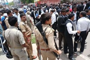 Lawyers and police at the site of the shooting in Allahabad on Thursday.