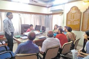 A Sreelakshmi, deputy conservator of forest(centre,seated), interacting with residents of Deccan on Wednesday.