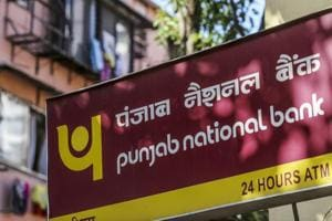Signage for Punjab National Bank (PNB) is displayed outside a branch in Mumbai, India.