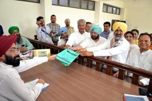 Congress candidate Hardev Singh Laddi Sherowalia along with CM Amarinder Singh and other Congress leaders filling his nomination papers for the Shahkot assembly bypoll, at Shahkot on Thursday.