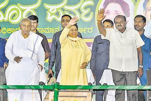 Bahujan Samaj Party chief Mayawati with former Prime Minister HD Deve Gowda (L) and JD(S) state president HD Kumaraswamy during a campaign for Karnataka assembly elections in Mysore in April.