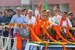 Uttar Pradesh chief minister Yogi Adityanath during a roadshow ahead of Karnataka Assembly elections in Bantwal.