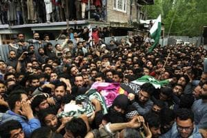 Villagers carry the body of deceased Mohammad Rafi Bhat, a Kashmir university professor, during his funeral procession at his home district of Ganderbal in Kashmir.