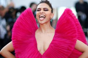 Deepika Padukone sticks out her tongue as she poses at the Cannes Film Festival.