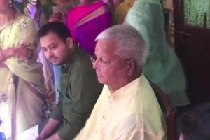 Lalu Prasad, seen with his son Tejashwi, during a ceremony ahead of the wedding in Patna.