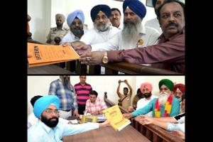 (Top)SAD candidate Naib Singh Kohar and (below) AAP's Rattan Singh Kakkar Kalan submitting nomination papers to SDM Jagjit Singh, the returning officer for Shahkot assembly bypoll, on Wednesday.
