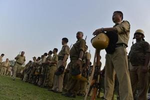Police personnel stand in queue to collect their duty schedule for the upcoming panchayat elections in Bengal.