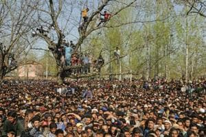 Kashmiri villagers attend the funeral of a militant.
