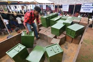 Election personnels distributing ballot boxes to polling officials at BDO office, on the eve of West Bengal panchayat elections in Birbhum district on May 13.