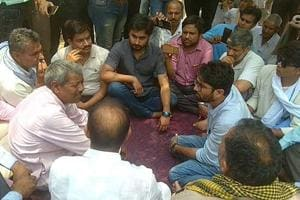 Gujarat Independent MLA Jignesh Mevani talks to Dalit families in Khairthal in Alwar on Sunday.