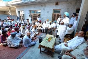 Congress candidate for Hardev Singh Ladi Sherowalia addressing a public meeting in village Jafarwal on the out skirts of Shahkot on Sunday.